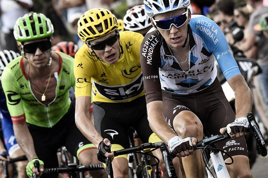 From left: Rigoberto Uran, Chris Froome and Romain Bardet wheel to wheel in the 15th stage of the Tour de France on Sunday.