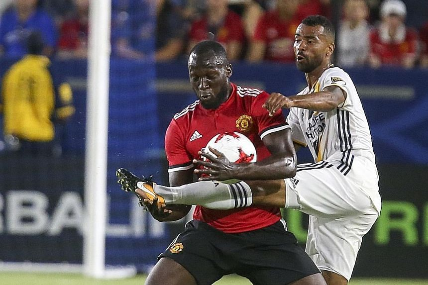 Manchester United's Romelu Lukaku (left) and Los Angeles Galaxy's Ashley Cole battling for the ball during a friendly match on Saturday in Carson City, California. United won 5-2 in the opening game of a five-match pre-season tour of the United State