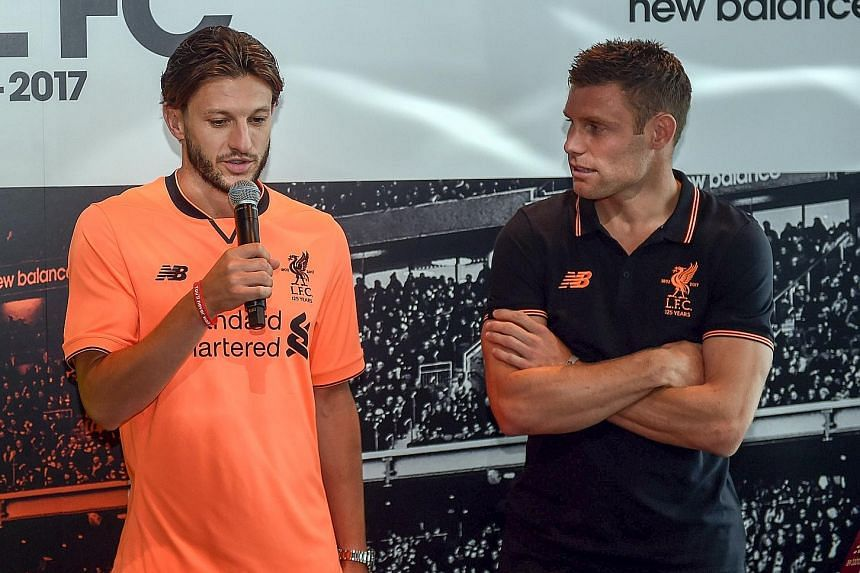 Adam Lallana sporting Liverpool's new third kit alongside vice-captain James Milner in Hong Kong. The Reds will play Crystal Palace tomorrow.