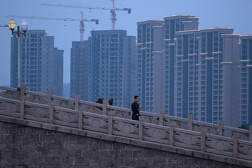 Apartment blocks in Shandong province. While growth in China's high-flying property sector has cooled this year, a rebound in exports has helped prevent a broader slowdown in the country's economy.