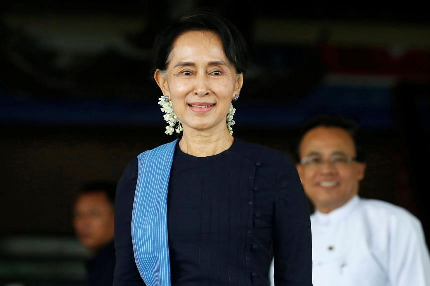Myanmar's Foreign Minister Aung San Suu Kyi smiles after a meeting with her Norwegian counterpart at Myanmar's Foreign Ministry in Naypyitaw, on July 6, 2017.