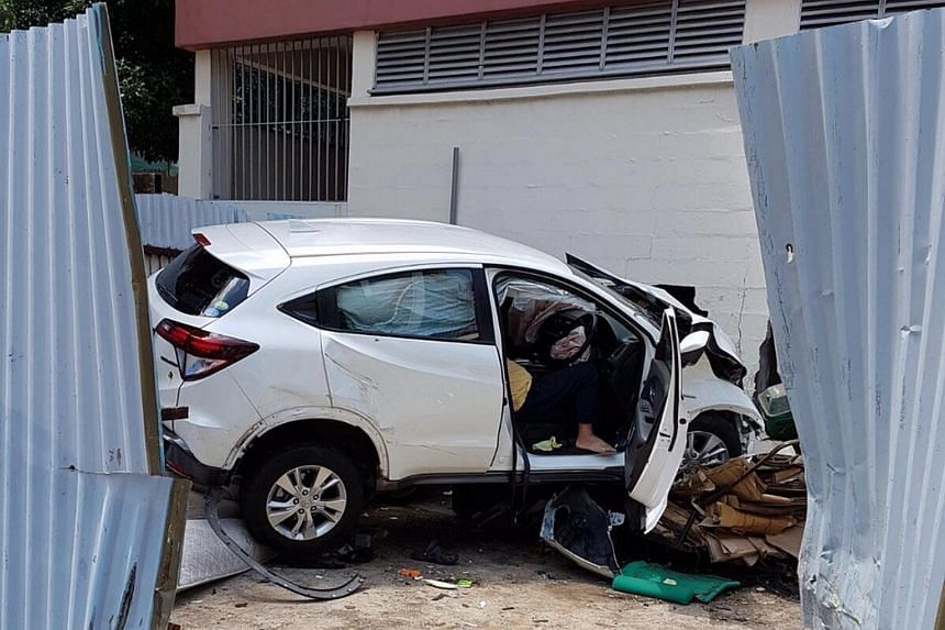 The car crashed through a metal hoarding and into a pile of rubbish at an open air carpark in Ang Mo Kio.