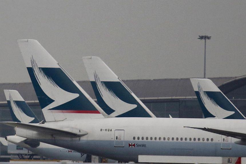 Passenger planes of Cathay Pacific Airways park at the Hong Kong Airport terminal in Hong Kong.