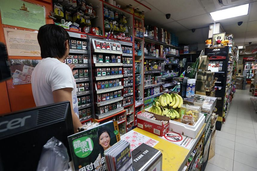 Cigarette packets displayed on a shelf behind the counter in a minimart in Toa Payoh North.