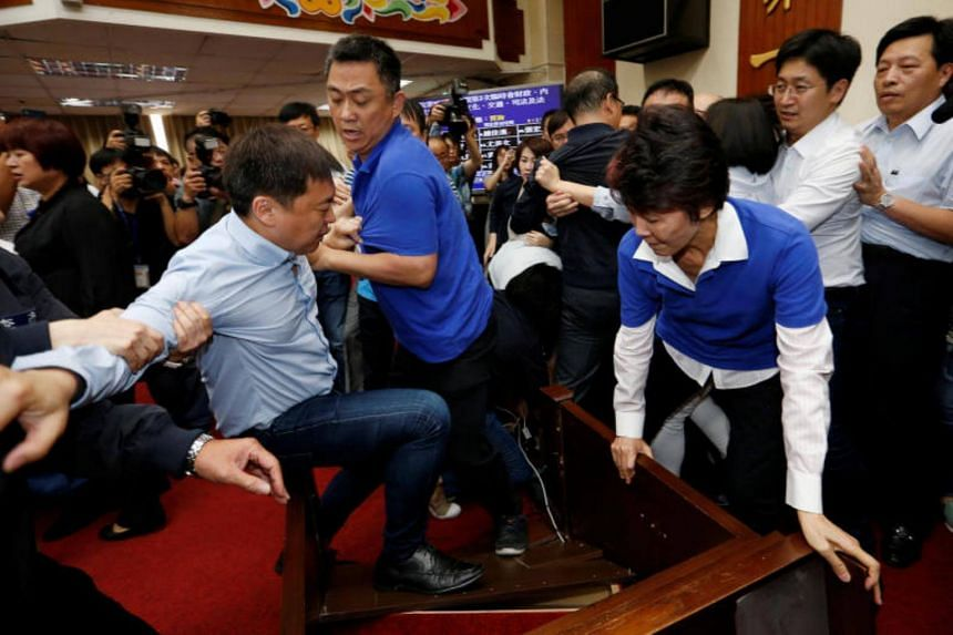 Democratic Progressive Party legislator Chao Tien-lin (left) scuffles with Kuomintang legislators during a budget meeting for the infrastructure development programme, at the Legislative Yuan in Taipei, on July 18, 2017.