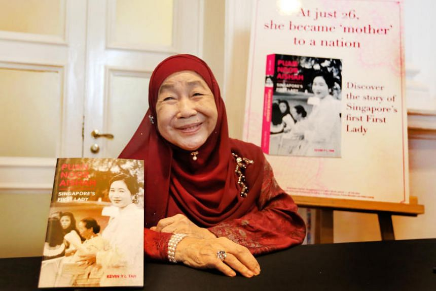 Puan Noor Aishah with the new book about her life at The Arts House on July 18, 2017.