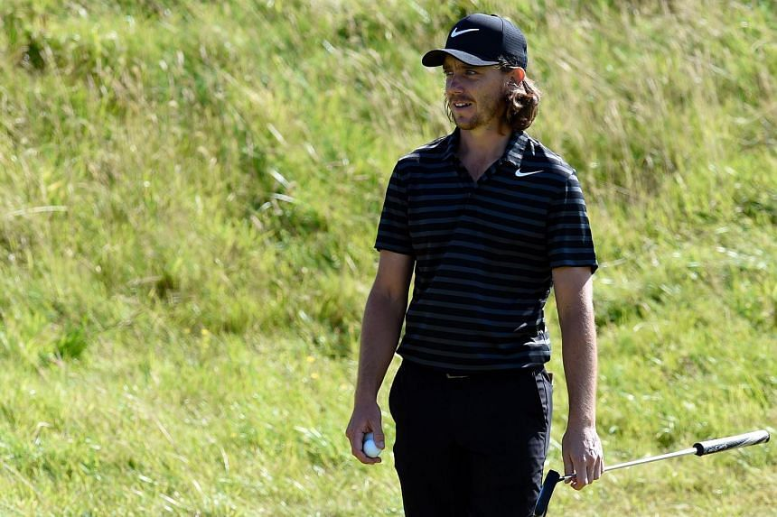 England's Tommy Fleetwood plays on the 4th green during a practice round at Royal Birkdale golf course ahead of the 146th Open Golf Championship near Southport, England on July 17, 2017.
