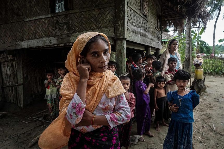 A Muslim family at Maung Hnama village, Buthidaung township in Myanmar's northern Rakhine state, on July 13, 2017.