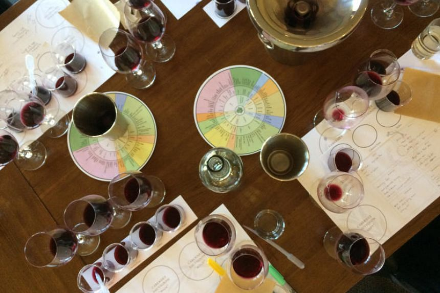 At Conn Creek Winery's wine-blending class, it takes an array of glasses, beakers, pipettes and charts, along with copious notes, to understand how different wine varietals come together to make a balanced glass. PHOTO: KRISTEN HARTKE FOR THE WASHING