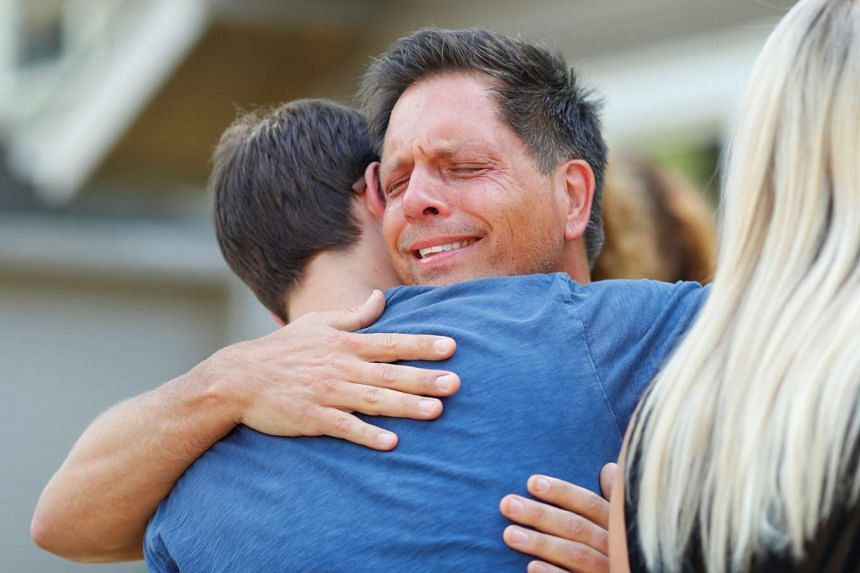 Don Damond hugs a neighbour after reading a statement about his fiance, Justine Damond who was fatally shot by Minneapolis police in Minneapolis, Minnesota, US, on July 17, 2017.