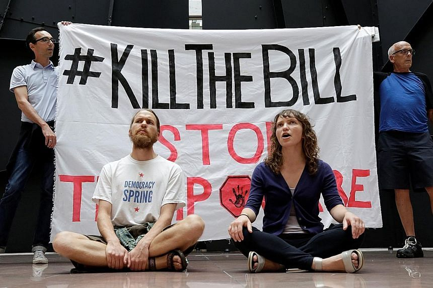 Activists in Washington protesting against the proposed Republican healthcare Bill.
