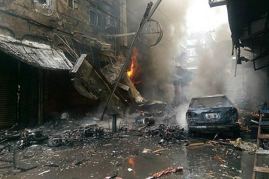 Left: The aftermath of the explosion at a restaurant in the central Taiwan city of Taichung yesterday. The fire also engulfed a clothing store, a noodle eatery, as well as residential units above the shops. Above: Gas cylinders found at the eatery wh