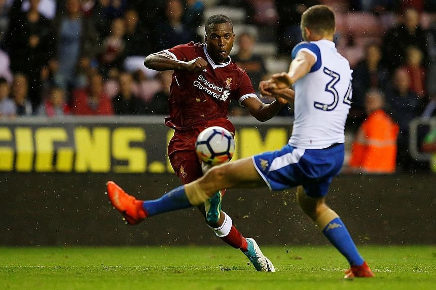 Liverpool forward Daniel Sturridge shooting against Wigan in a friendly. The England international is a key part of manager Jurgen Klopp's plans for the new season.