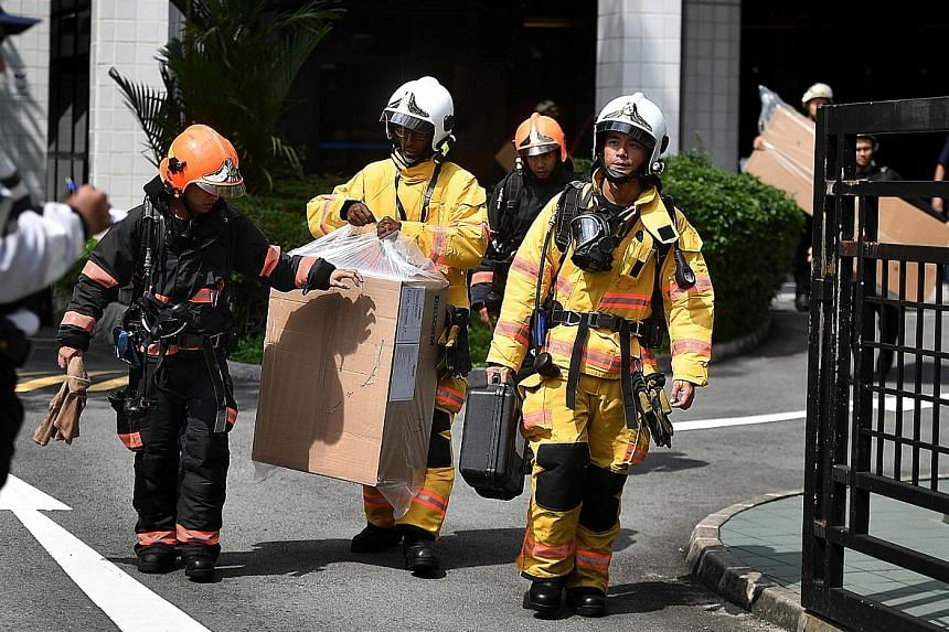 Above: SCDF and HazMat officers at the scene of the incident. At about 3.50pm yesterday, the SCDF said its HazMat detectors showed no reading of the chemical vapour in the production room. The surrounding environment was also declared safe, with no t