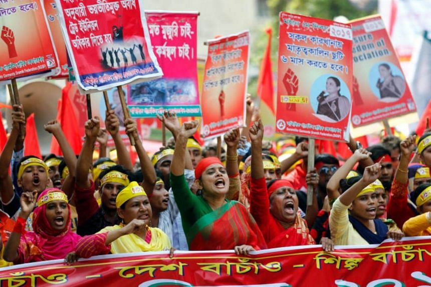 Protesters shout slogans demanding reasonable wages and workers' safety during an International Labor Day rally in Dhaka, Bangladesh May 1, 2017.