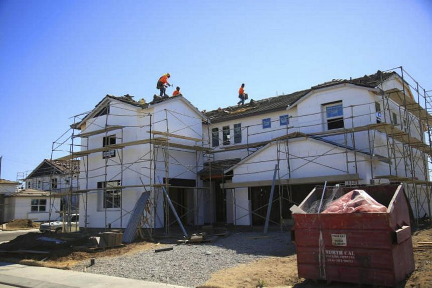 Houses under construction in Manteca, California on June 27, 2017.