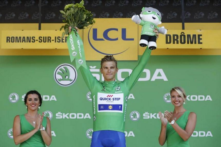 Quick Step Floors team rider Marcel Kittel of Germany celebrates on the podium retaining the best sprinter's green jersey following the 16th stage of the 104th edition of the Tour de France cycling race over 165 km between Le Puy-en-Velay and Romans-