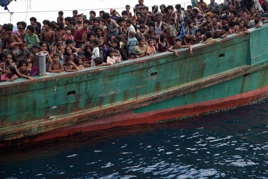 Rohingya migrants in a boat drifting in Thai waters off the southern island of Koh Lipe in the Andaman Sea.