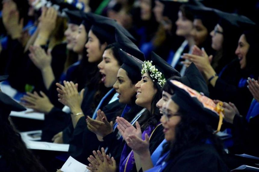 Students listen as Hillary Clinton speaks at commencement at Wellesley College on May 26, 2017 in Wellesley, Massachusetts.
