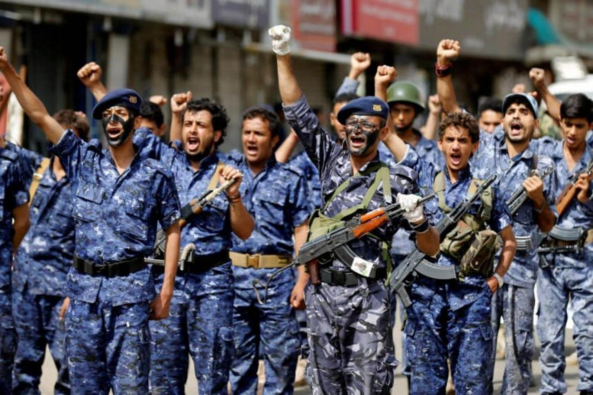 Members of a security force loyal to the Houthi rebels take part in a military parade at the Tahrir Square in downtown Sanaa, Yemen on July 19, 2017.