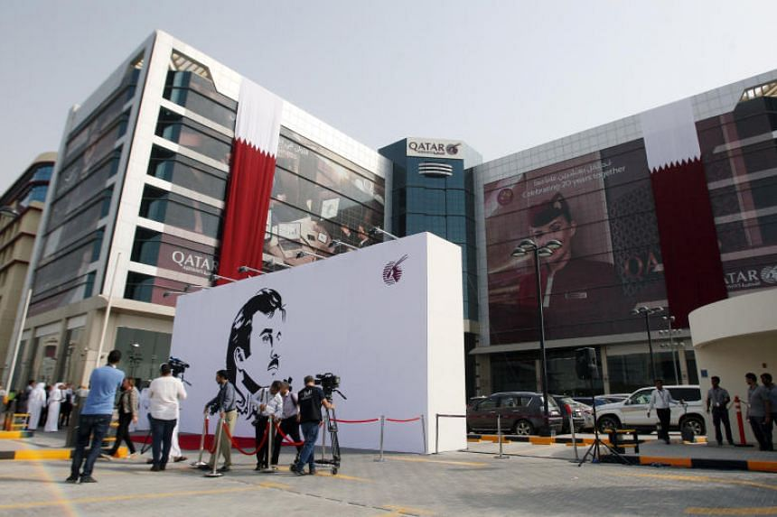 A commemorative signing wall is seen outside the Qatar Airways building in Doha, Qatar in Doha, Qatar on July 13, 2017.