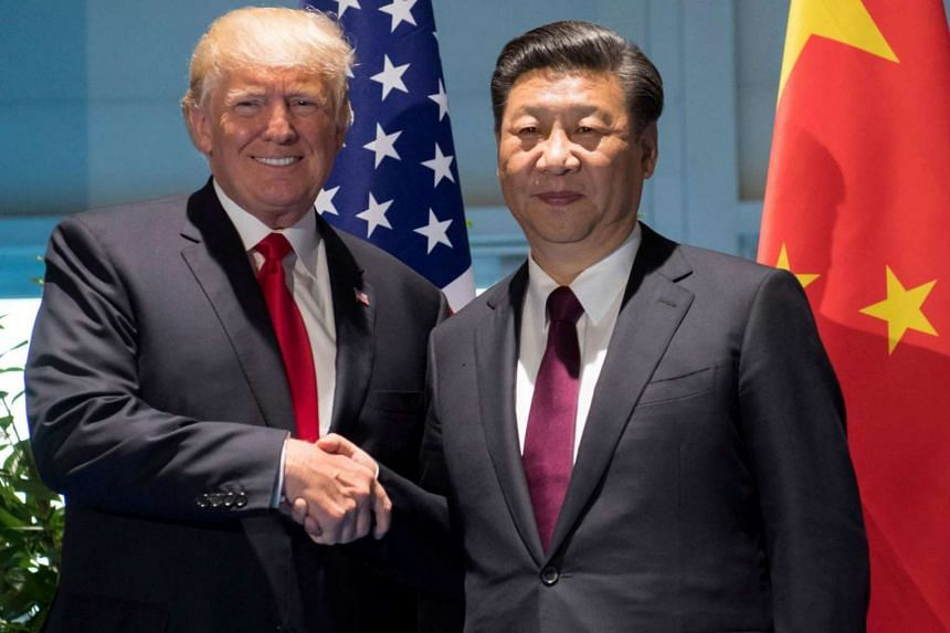 US President Donald Trump and Chinese President Xi Jinping (right) shake hands prior to a meeting on the sidelines of the G20 Summit in Hamburg, Germany.