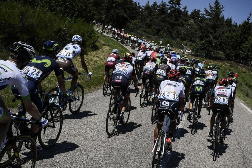The pack rides during the 165km sixteenth stage of the 104th edition of the Tour de France cycling race between Le Puy-en-Velay and Romans-sur-Isere, on July 18, 2017.
