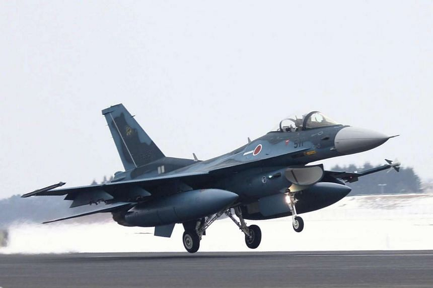 An F-2 fighter takes off from a runway at the ASDF's Misawa Air Base.