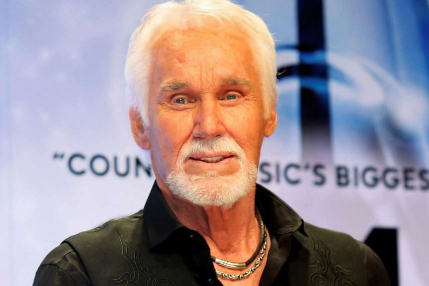 Kenny Rogers poses backstage after accepting the Willie Nelson Lifetime Achievement award at the 47th Country Music Association Awards in Nashville.