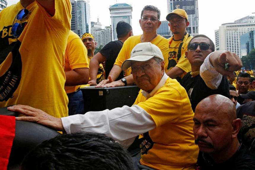Former Malaysian PM Mahathir Mohammad arrives to speak at a rally by pro-democracy group Bersih during a 1MDB protest, on Nov 19, 2016.