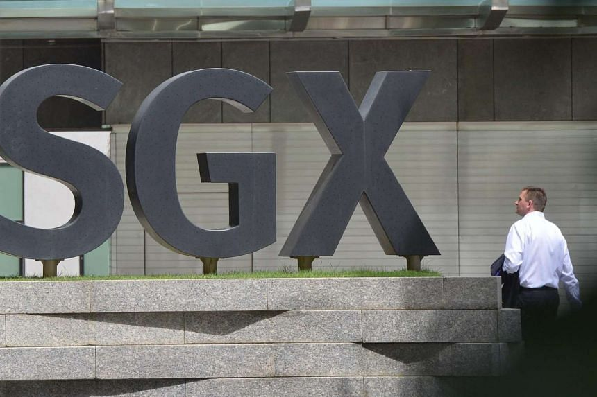 A man walking past the SGX building.