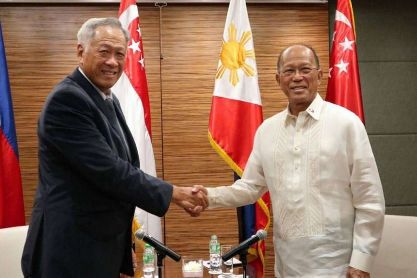 Defence Minister Ng Eng Hen shakes hands with Philippine Secretary of National Defense Delfin Lorenzana at a meeting in Manila.