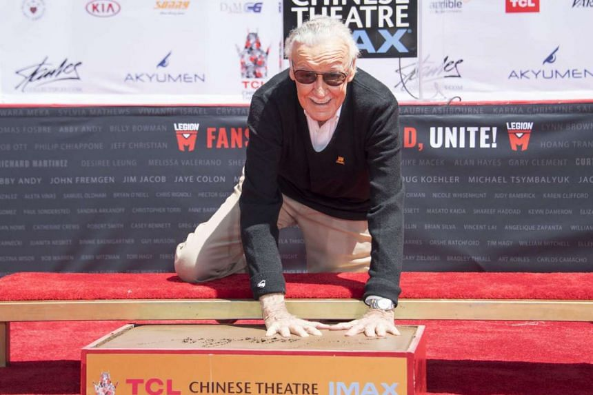 Comic-book writer, editor, and publisher Stan Lee places his hands in cement during his hand and footprint ceremony at TCL Chinese Theatre IMAX in Hollywood, California, on July 18, 2017.