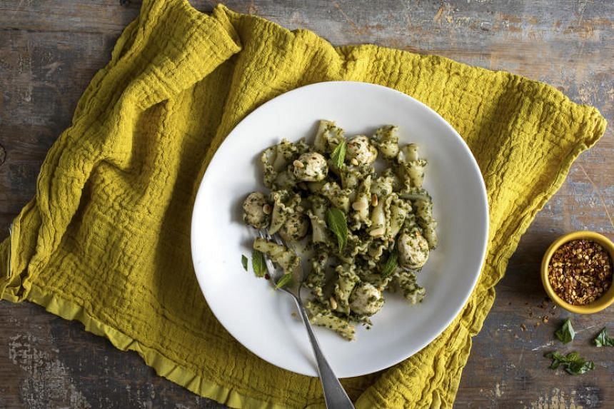 This light herb and pasta dish uses the heat from freshly boiled pasta to melt the mozzarella without requiring an oven.