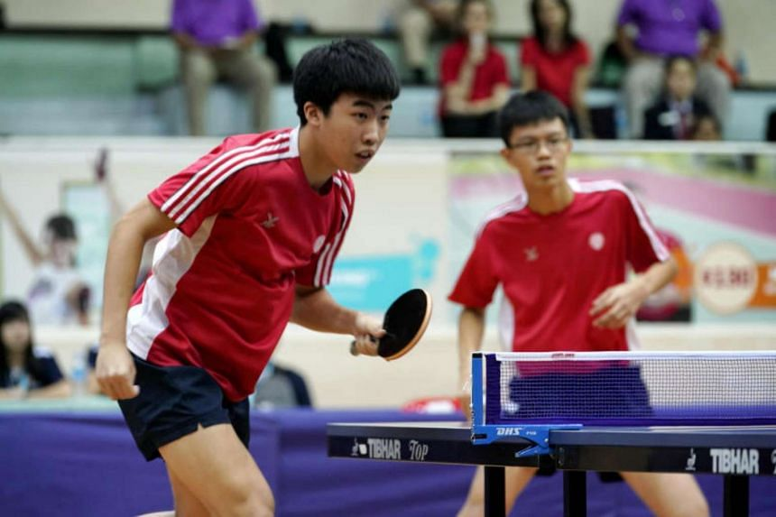 Singapore's Gerald Yu (left) and Josh Chua playing in the boys' doubles final against Vietnam.