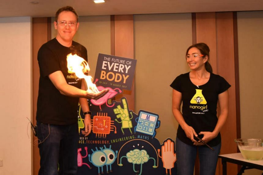 Mr Joe Davis and Dr Michelle Dickinson from NanoGirl Science Show demonstrating a science experiment.