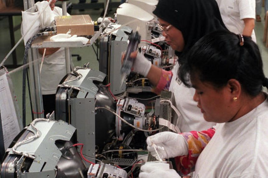 A file picture of Singapore Technologies Electronics production operators. PHOTO: SPH