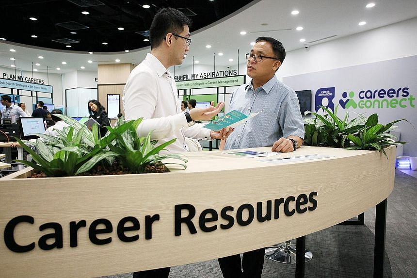 Mr Chong Choon Yew (right) with career coach Andrew Er at Workforce Singapore's Careers Connect centre at the Lifelong Learning Institute in Paya Lebar. After 20 years as a product engineer, Mr Chong made the switch to become a care coordinator at th