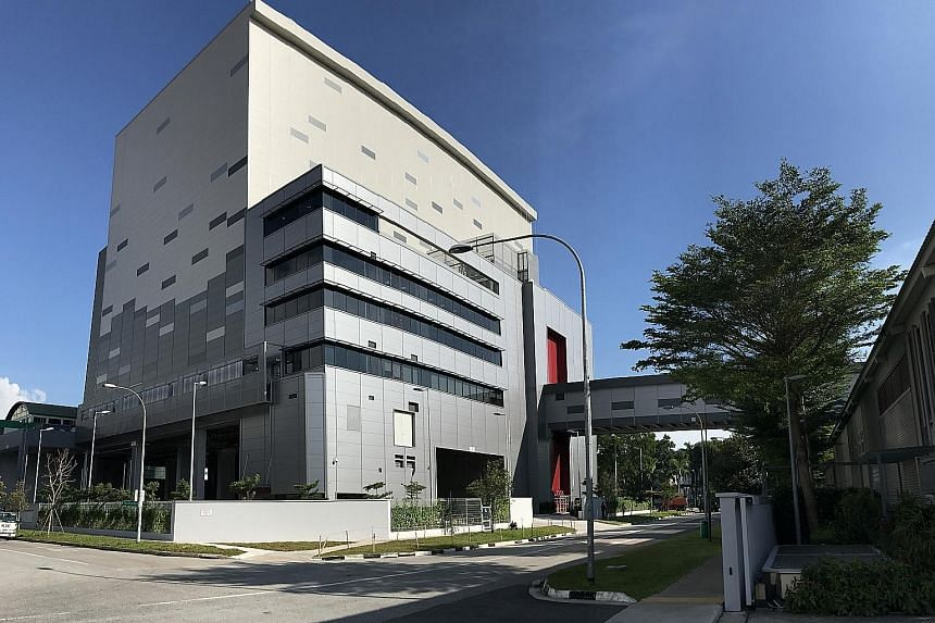 The 6,000 sq m four-storey warehouse is connected to Cola-Cola Singapore's concentrate plant via an overhead bridge.