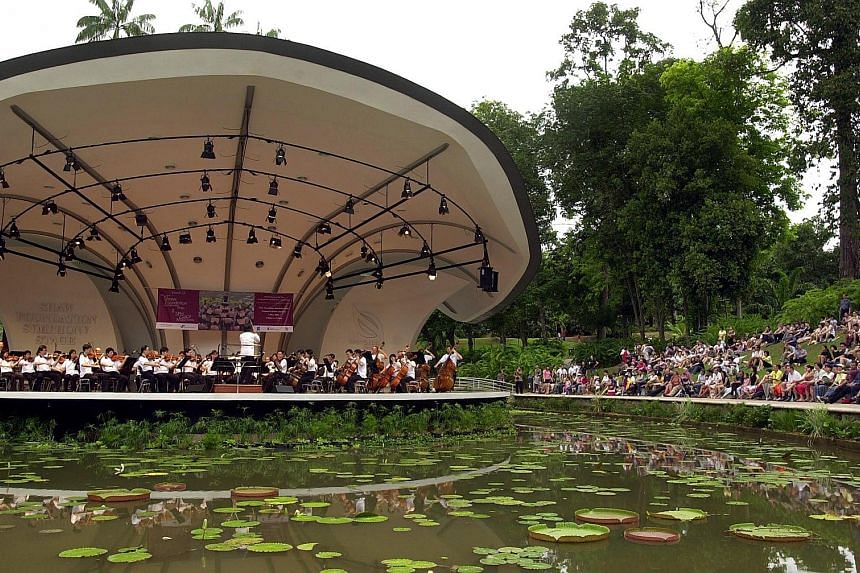 The SSO performing at a previous Singapore Press Holdings' Gift of Music concert at the Botanic Gardens. On Saturday, it will perform music from the popular musical West Side Story, among other well-loved classics.