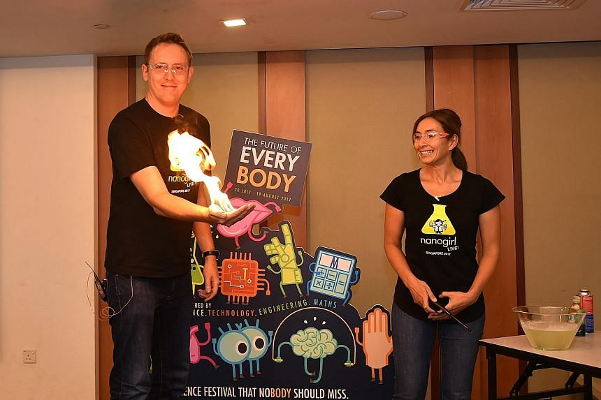 Mr Joe Davis and Dr Michelle Dickinson from the NanoGirl Science Show demonstrate a science experiment.