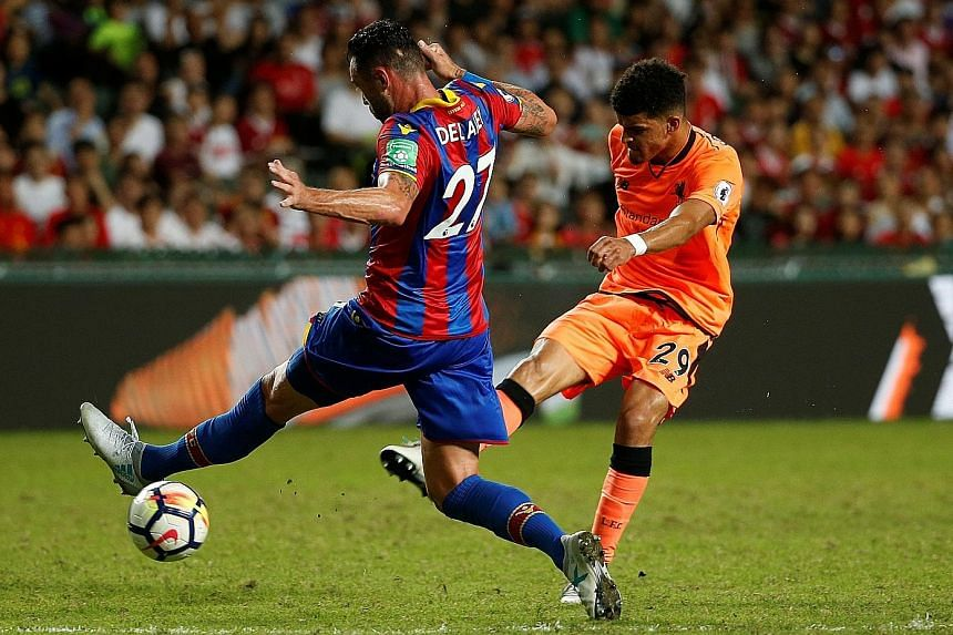 Crystal Palace defender Damien Delaney is unable to stop Liverpool's new striker Dominic Solanke from scoring the opening goal in Hong Kong yesterday. The Reds won the Premier League Asia Trophy match 2-0.