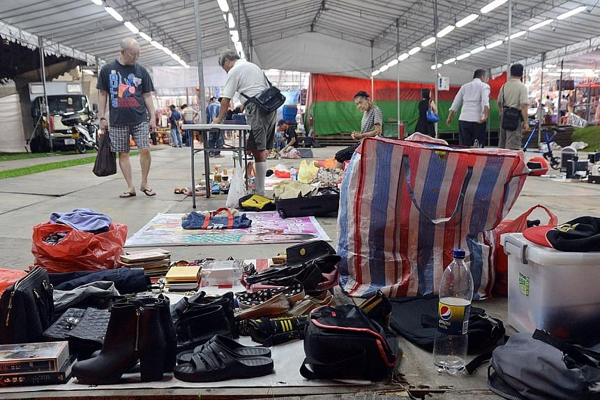 Former Sungei Road vendors, unable to sell their goods at the now-defunct Sungei Road market, opened shop once again at a pasar malam (night market) in Sembawang yesterday evening. The Sungei Road market, also known as the Thieves' Market, was closed
