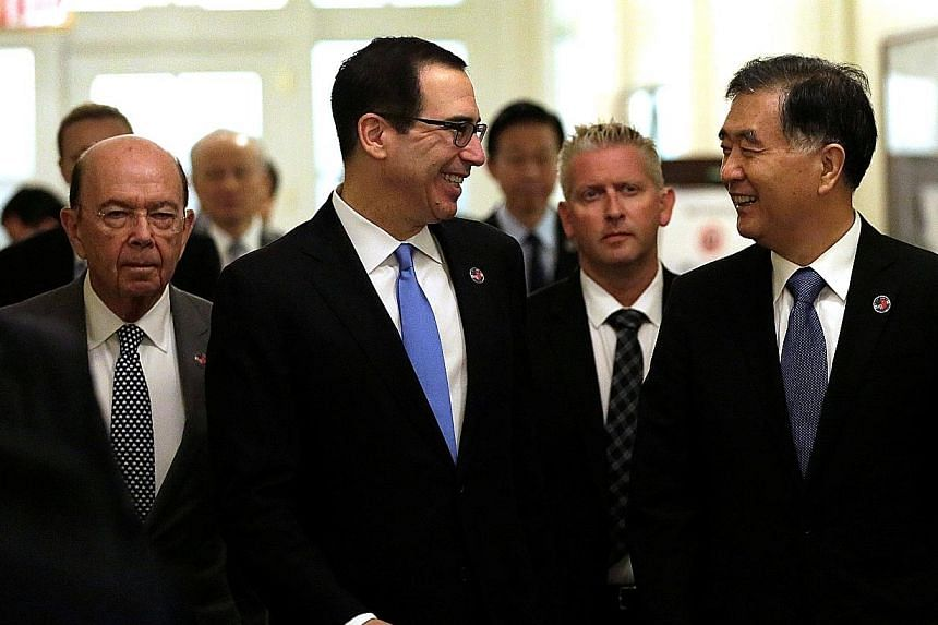 (From left) US Commerce Secretary Wilbur Ross, Treasury Secretary Steven Mnuchin and Chinese Vice-Premier Wang Yang arriving for the US-China economic dialogue in Washington yesterday.