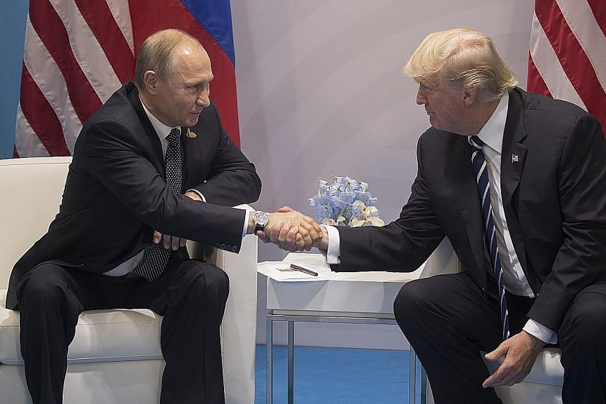 Russian President Vladimir Putin and US President Donald Trump meeting during the G-20 summit in Hamburg, Germany, on July 7. Later that day, the two leaders had a second, previously undisclosed meeting, one in which there is no official US governmen