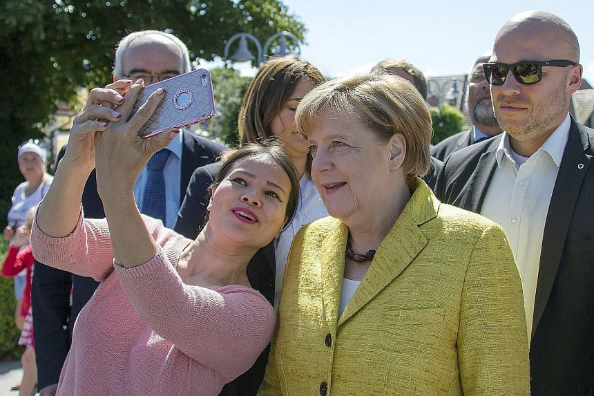 German Chancellor Angela Merkel during her summer tour in Zingst, Germany. Dr Merkel has come under attack at home and abroad over the European powerhouse's balance sheets ahead of her country's general elections. But Germans support her government's