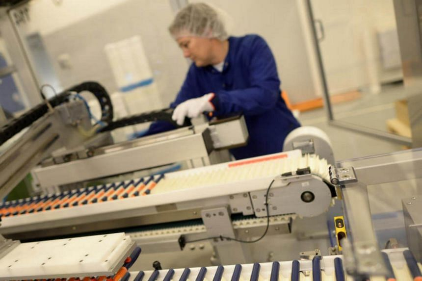 A Novo Nordisk employee controls a machine at an insulin production line in a plant in Kalundborg, Denmark.