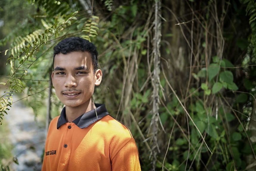 Ivanudin Siagian, 17, an intern at Mr Suryono's farm, says the experience at the farm has given him valuable skills and knowledge. He aspires to own his own business in the future.