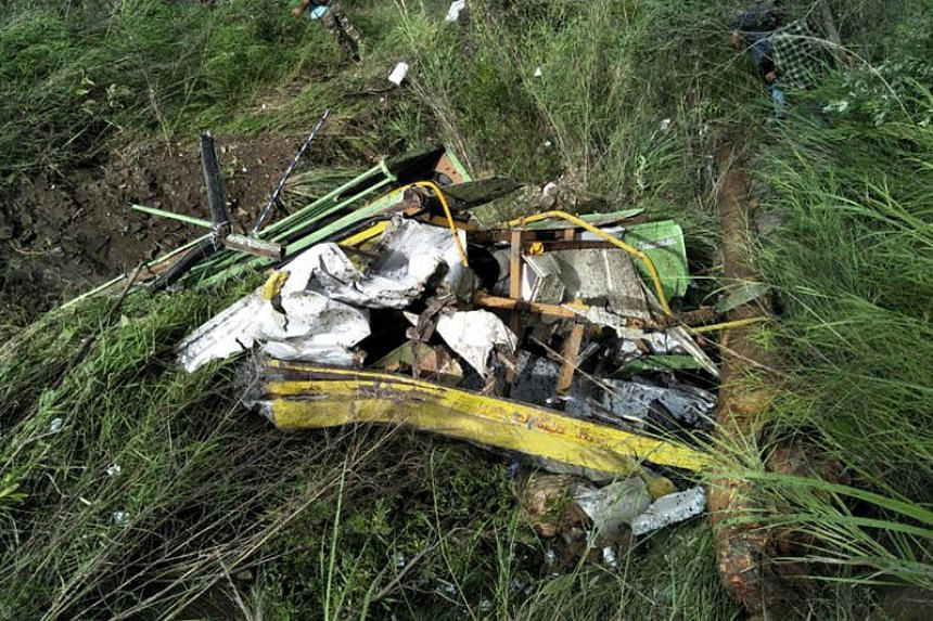 The wreckage of a bus lies in a gorge following an accident near the Indian town of Rampur on July 20, 2017.