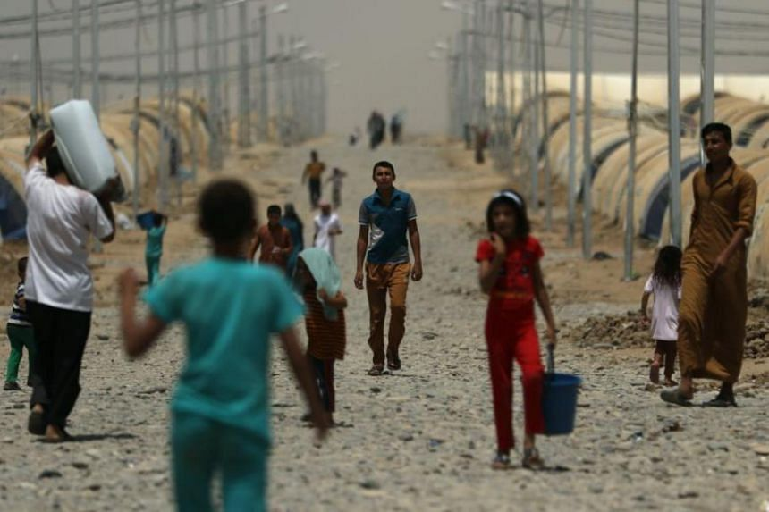 Displaced Iraqis at the Jadaah camp on the outskirts of Al-Qayyarah, south of Mosul, on July 19.